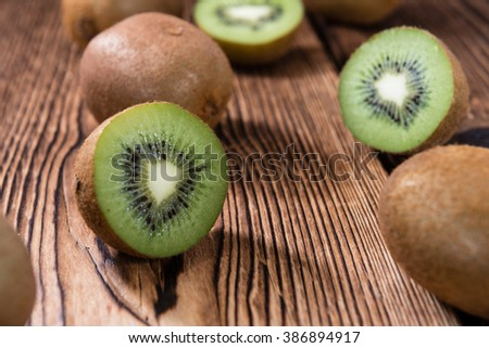 Kiwi Fruits (selective focus) on an old wooden table