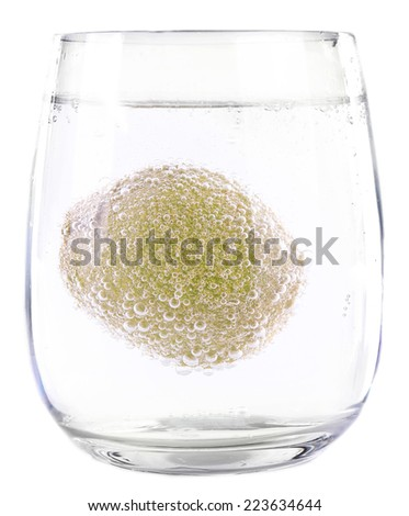 Kiwi in glass of water isolated on white