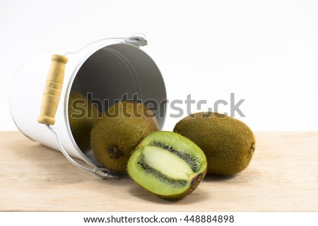 Kiwi in  white tank on wood and white background.Fruit for health and Hi-vitamin or food for health.