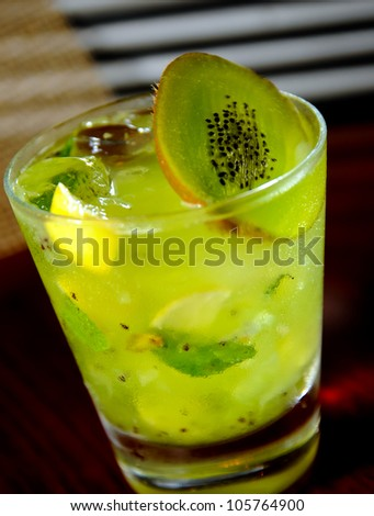 Kiwi mojito close up on the a wooden table - stock photo