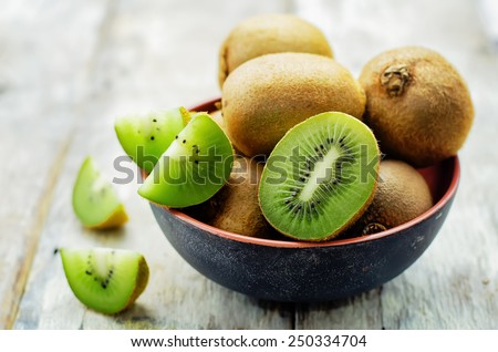 kiwi on white wood background. tinting. selective focus - stock photo