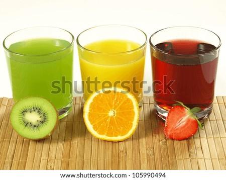 Kiwi, orange and strawberry fruit with fresh juices - stock photo