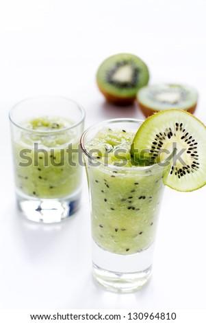 kiwi smoothie on white background - stock photo