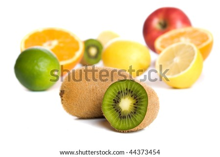 Kiwi with other tropical and citrus fruit isolated on white