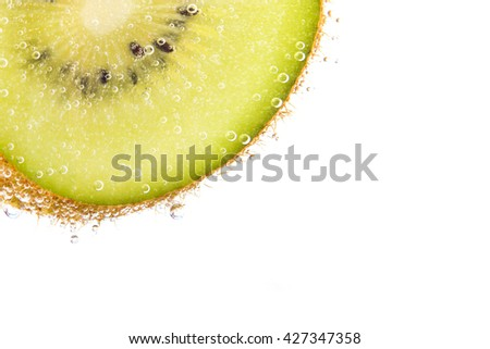 Kiwi with water bubbles on a white background
