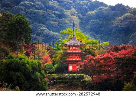 Kiyomizu-dera in autumn season,The leave change color of red castle in japan - stock photo