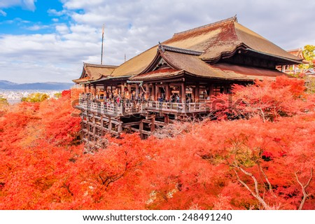 Kiyomizu-dera stage with fall colored leaves in Kyoto, Japan - stock photo