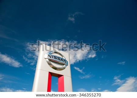 KLAIPEDA-JUL 26: Nissan dealership logo on July 26, 2015, Klaipeda, Lithuania. Nissan Motor Corporation is a Japanese multinational automobile manufacturer headquartered in Nishi-ku, Yokohama, Japan. - stock photo