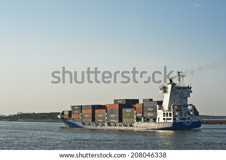 KLAIPEDA, LITHUANIA - JULY 30: CONTAINERSHIP in Klaipeda harbor on July 30, 2014 in Klaipeda, Lithuania.