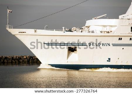 KLAIPEDA,LITHUANIA- JUNE 11:cruise liner DELPHIN in port on June 11,2012 in Klaipeda,Lithuania. - stock photo