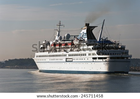KLAIPEDA,LITHUANIA-JUNE 11:cruise liner DELPHIN in port on June 11,2012 in Klaipeda,Lithuania.MV Delphin is a cruise ship owned by the India-based Vishal Cruises Pvt. Ltd. - stock photo