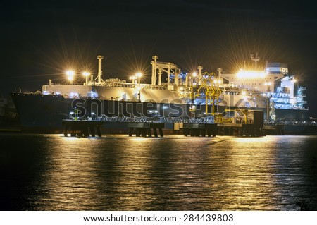 KLAIPEDA,LITHUANIA- MAY 25:The liquefied-natural-g as (LNG) ship Independence in Klaipeda port at night on May 25,2015 in Klaipeda,Lithuania.