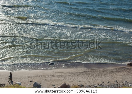 KLAIPEDA, LITHUANIA - September 28, 2012: Couple is walking on the beach of Baltic Sea