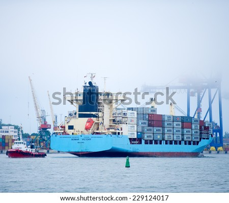 KLAIPEDA - MAY 31: MAERSK Container Ship BOMAR VICTORY in Klaipeda harbor on May 31, 2014 Klaipeda, Lithuania. A.P. Moller Maersk Group, also known as Maersk, is a Danish business conglomerate.
