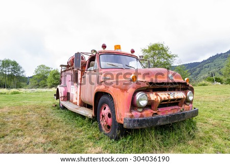 Klamath, California - June 16 : Old ford fire truck rusting away in a meadow, June 16 2015 Klamath, California.