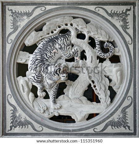KLANG, MALAYSIA - SEPTEMBER 16: Facade of a granite stone carving of a tiger which is the third symbol in the Chinese horoscope in the Kuan Yin Buddhist Temple on September 16, 2012 in Klang, Malaysia - stock photo