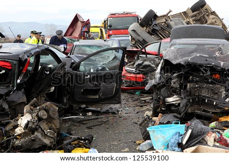 KLEIDI,GREECE - JAN,22: 28 vehicle pile-up on the Egnatia motorway in Kleidi after the crash that occurred early today due to fog on 22 January, 2013. One woman died and 26 others where injured - stock photo