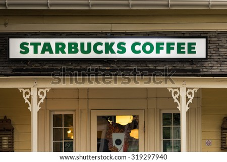 KLEINBURG-SEPTEMBER 19: Starbucks Coffee  Starbucks is the largest coffeehouse company in the world. The entrance of this store was photographed in Kleinburg, Ontario on September 19, 2015. - stock photo