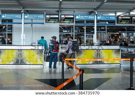 KLIA, MALAYSIA 29 FEB 2016 : Travellers queue to check-in at Kuala Lumpur International Airport (KLIA). KLIA has the capacity to carry 70 million passengers per year. - stock photo