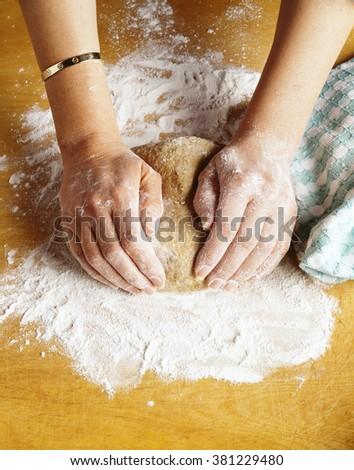 Kneading bread dough - stock photo