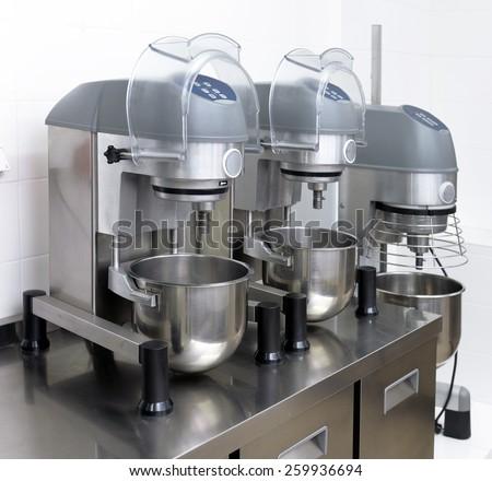 kneading machine in a restaurant kitchen - stock photo