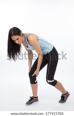 Knee injury for young athlete - stock photo