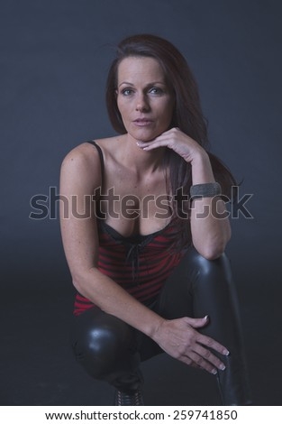 Kneeling middle aged woman - stock photo