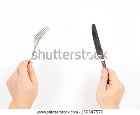 Knife and fork in hands isolated on white background - stock photo