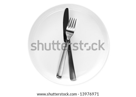 Knife and fork on white plate.  Clipping path included.