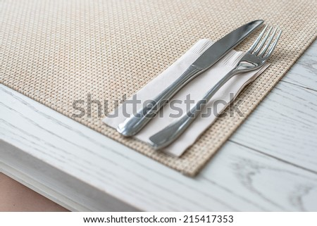 Knife and fork on wooden