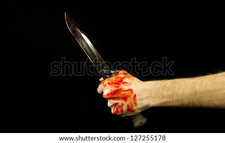 knife and hand - stock photo