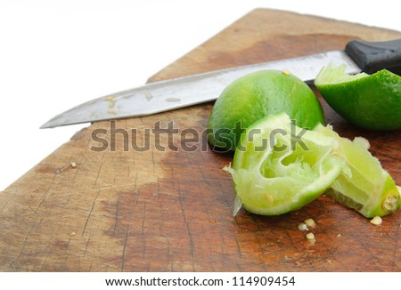 Knife and lime on wood cutting board