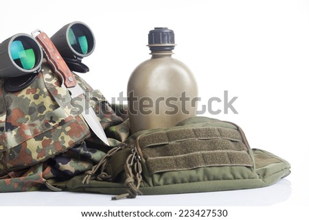 Knife and military equipment with helmet, and binoculars - stock photo