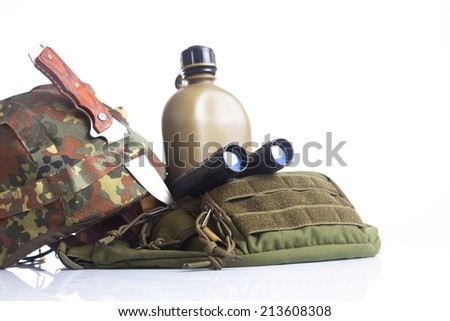 Knife and military equipment with helmet, and binoculars isolated on white - stock photo