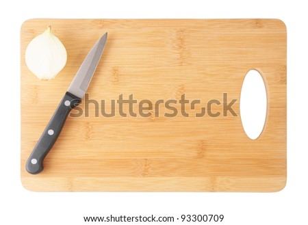 Knife and onion on cutting board isolated