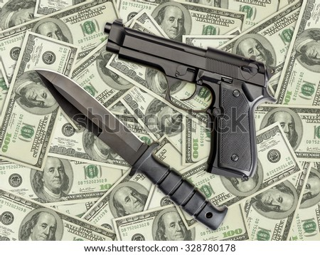 Knife and pistol placed on pile of american one hundred dollar bills - stock photo