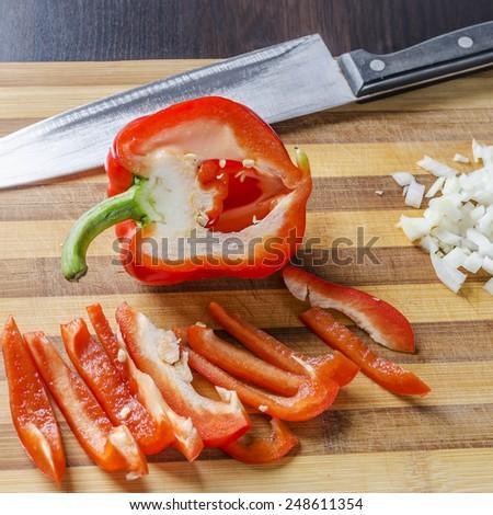knife and sliced paprika - stock photo