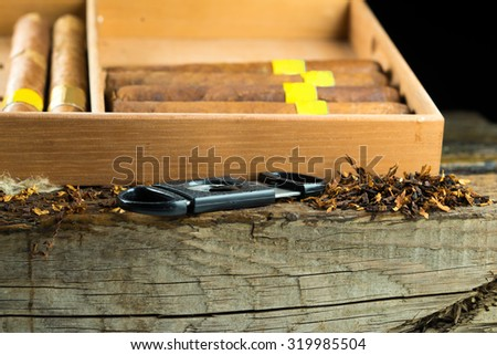Knife cigar is near the box with cigars - stock photo