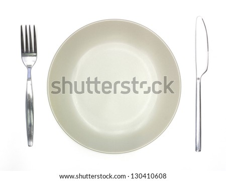 Knife, cream plate and fork isolated on white background