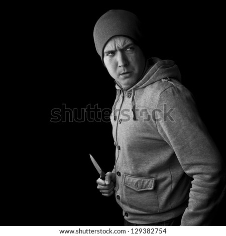 knife crime, man with knife black and white with copy space - stock photo