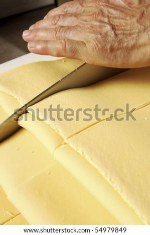 Knife cutting fresh pasta - stock photo