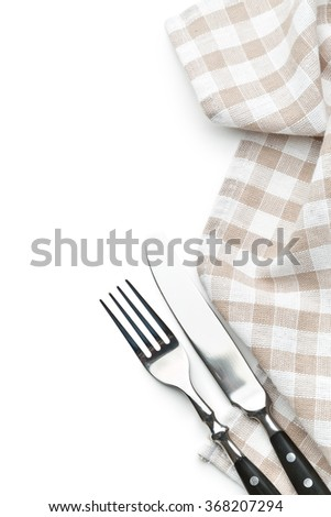 knife, fork and checkerd napkin on white background - stock photo