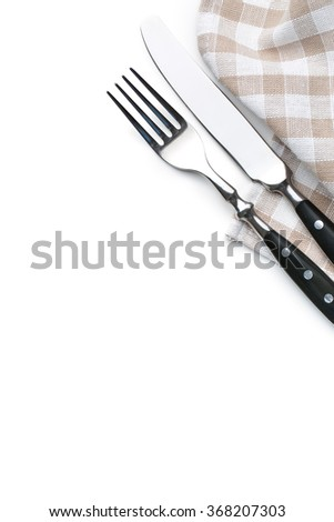 knife, fork and checkerd napkin on white background