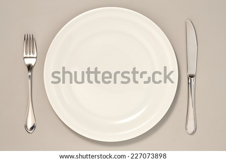 Knife, Fork and Spoon Collection isolated on Grey Background with Real Shadow. Top View