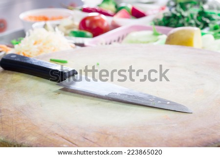 Knife in the kitchen with vegetable background - stock photo