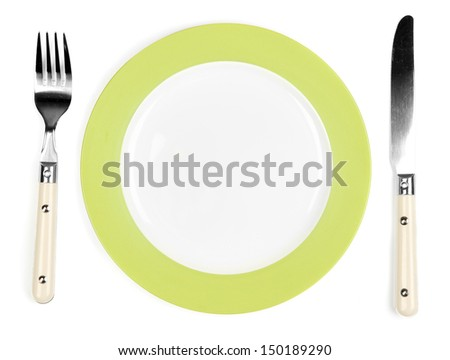 Knife, white plate and fork, isolated on white