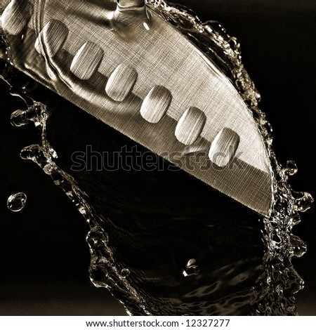 Knife with water - stock photo