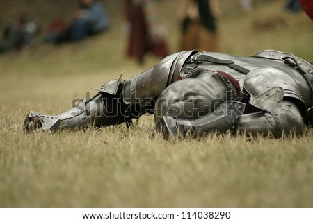 Knight defeated on the battlefield - stock photo