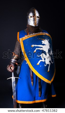 Knight is standing with sword and shield - stock photo