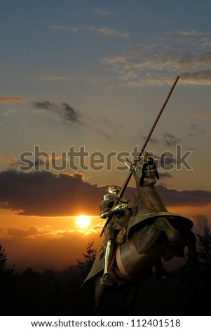 Knight on horseback, against the clouds, with lance - stock photo